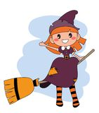 Cute redheaded witch flying on a broom over blue sky Royalty Free Stock Photos
