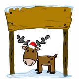 Cute reindeer cartoons and wood banner and christmas hat Royalty Free Stock Image