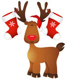 Cute reindeer with Christmas stocking Royalty Free Stock Photos