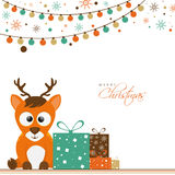 Cute reindeer with gifts for Merry Christmas. Royalty Free Stock Photography