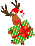 Cute reindeer holding a Christmas gift Stock Images