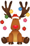 Cute reindeer sitting with glass ball Christmas Royalty Free Stock Photos