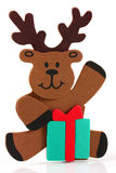 Cute reindeer sitting with a present. On a white background royalty free illustration