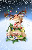 Cute reindeer wishes You merry Christmas!. Worth box with gifts Stock Photography