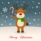 A Cute Reindeer Wishing a Merry Christmas. A merry Christmas greeting card with a happy reindeer smiling and holding a candy cane in a snowy scene. Eps file Stock Images