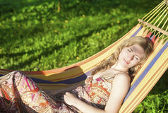Cute Relaxing Caucasian Lady Resting in Hummock and Dreaming Outdoors Stock Image