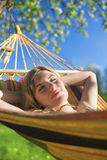 Cute Relaxing Caucasian Lady Resting in Hummock and Dreaming Stock Photography