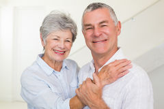 Cute retired couple smiling at camera Stock Photo