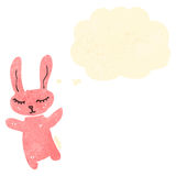 Cute retro cartoon rabbit with thought bubble Royalty Free Stock Images