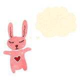 cute retro cartoon rabbit with thought bubble Stock Image