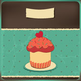 Cute retro cupcake in frame Royalty Free Stock Image