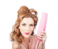 Cute retro female hairdresser with big hair comb Royalty Free Stock Photo