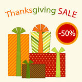 Cute retro festive present boxes with ribbons in traditional autumn colors as Thanksgiving Sale banner Royalty Free Stock Image