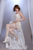 Cute retro fifties bride in lingerie Stock Images