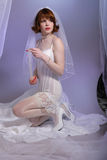Cute retro fifties bride in lingerie Royalty Free Stock Images