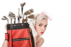 Cute retro girl peeking out from behind red golf bag, isolated o Royalty Free Stock Images