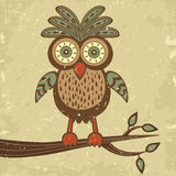 Cute retro style owl on a branch Royalty Free Stock Photo