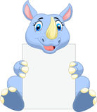 Cute rhino cartoon holding blank sign Stock Photography