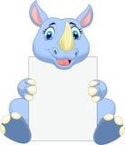Cute rhino cartoon holding blank sign Stock Photography