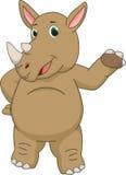 Cute rhino cartoon presenting Stock Photos