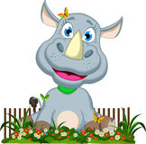 Cute rhino cartoon sitting on flower garden Royalty Free Stock Photo