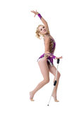 Cute rhythmic gymnast performs with maces Stock Photo