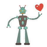 Cute robot in love holding heart Royalty Free Stock Photos