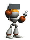 Cute robot is taking a picture by himself. Stock Photos