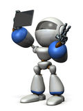 Cute robot is taking a picture by himself. Stock Photo