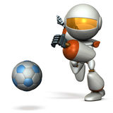 Cute robot is trying to kick a soccer ball. Royalty Free Stock Photo