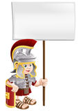 Cute Roman soldier holding sign board Royalty Free Stock Photography