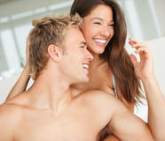 Cute romantic couple enjoying in bed Royalty Free Stock Image