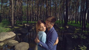 Cute romantic pair in park. stock footage