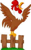 Cute rooster cartoon crowing on the fence Royalty Free Stock Photography