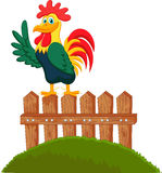 Cute rooster crowing on the fence Royalty Free Stock Photography