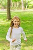 Cute running girl stock photo