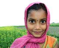 Cute rural Bangladeshi child. In front of a flourishing mustard field Royalty Free Stock Image