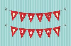 Cute rustic bunting flags with hearts ideal for Valentines day. Or as wedding decoration Stock Images