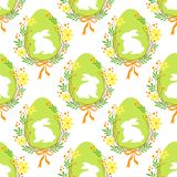 Cute rustic hand drawn Easter seamless pattern with wreath of spring flowers, egg and bunny. For your decoration Royalty Free Stock Photography