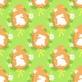 Cute rustic hand drawn Easter seamless pattern with wreath of spring flowers, egg and bunny. For your decoration Stock Photo