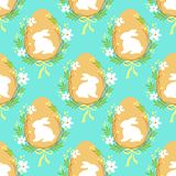 Cute rustic hand drawn Easter seamless pattern with wreath of spring flowers, egg and bunny. For your decoration Stock Image