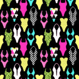 Cute 80s style geometric seamless pattern with swimsuits Stock Photos