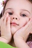 Cute sad little girl close-up. Studio shot Stock Photography