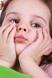 Cute sad little girl close-up. Studio shot Royalty Free Stock Photography