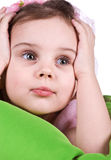 Cute sad little girl close-up. Studio shot Stock Image