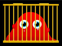 Cute sad monster in a cage Stock Photography