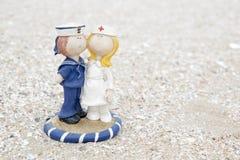 Cute sailor and nurse doll on beach Stock Photo