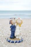 Cute sailor and nurse doll on beach Royalty Free Stock Photo