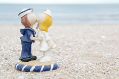 Cute sailor and nurse doll on beach Royalty Free Stock Images