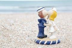 Cute sailor and nurse doll on beach Stock Image